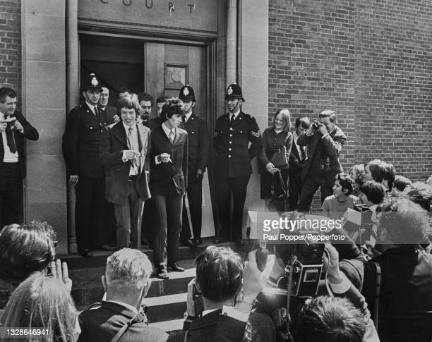 From left, Mick Jagger and Keith Richards of English rock group The Rolling Stones stand together on the steps of Chichester courthouse after...