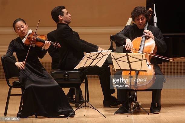 From left Midori Jonathan Biss and Antoine Lederlin performing Schubert's 'Piano Trio No 1 in Bflat Major' at Carnegie Hall on Tuesday night April 5...