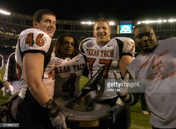 Mike Smith Johnnie Mack Dylan Gandy and Chris Hudler pose with Pacific Life Holiday Bowl Championship trophy after 4531 victory over Cal in the...