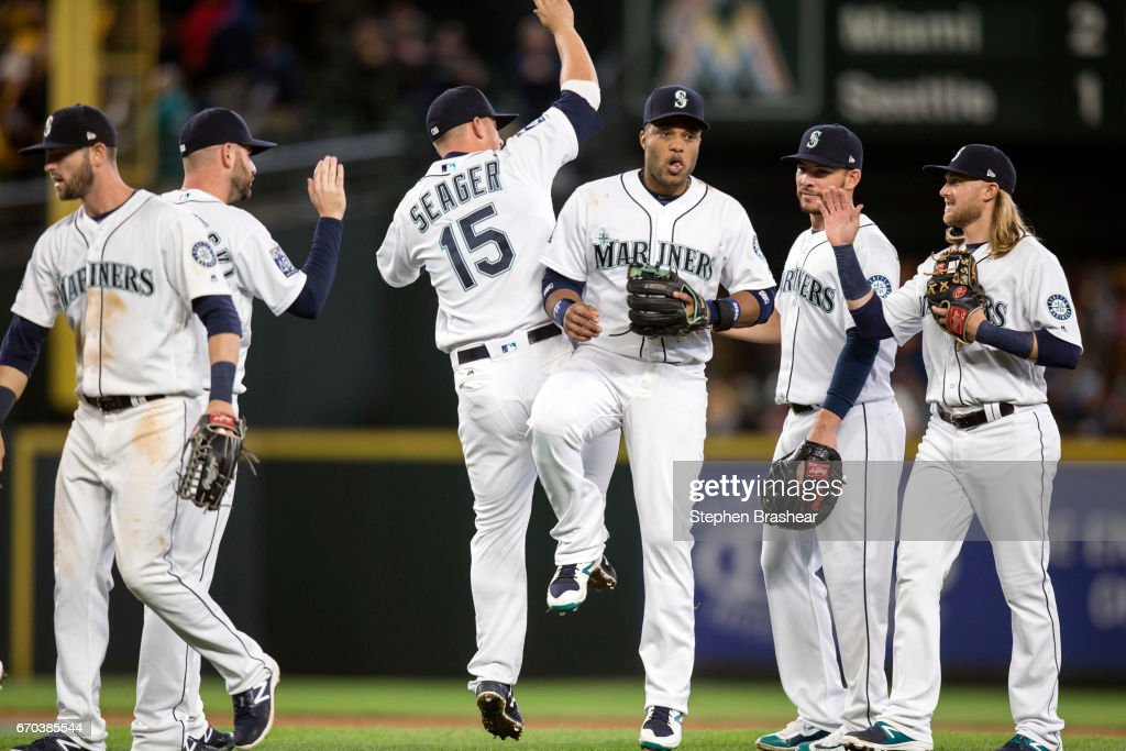 From left, Mitch Haniger #17 of the Seattle Mariners, Marc Rzepczynski #25 of the Seattle Mariners, Kyle Seager #15 of the Seattle Mariners, Robinson Cano #22 of the Seattle Mariners, Danny Valencia #26 of the Seattle Mariners and Taylor Motter #21 of the Seattle Mariners celebrate victory over the Miami Marlins after a game at Safeco Field on April 19, 2017 in Seattle, Washington. The Mariners won 10-5.