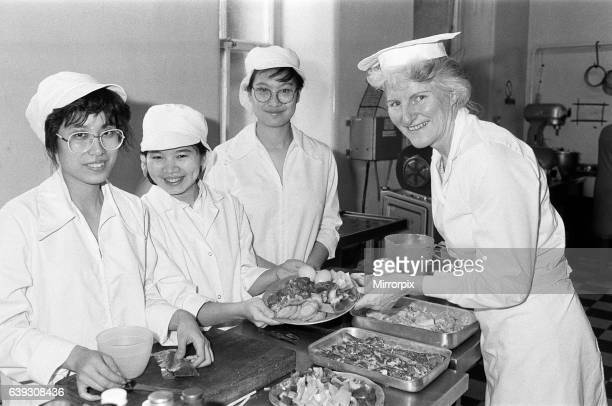 From left Mona Chan yu Chun Velly Intan and Michelle Li Cho Man discuss a Chinese meal with Mrs Anne Tinker senior lecturer Food Preparation during...