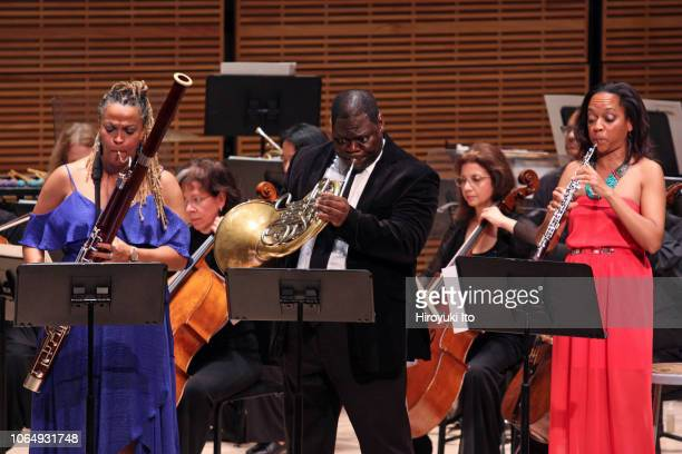 From left, Monica Ellis on bassoon, Jeff Scott on french horn and Toyin Spellman-Diaz on oboe, of Imani Winds, performing Valerie Coleman's...