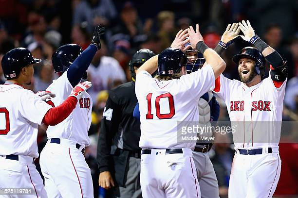 From left Mookie Betts of the Boston Red Sox Jackie Bradley Jr #25 and Ryan Hanigan congratulate Dustin Pedroia after he hit a grand slam during the...