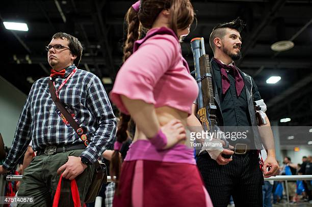 From left Mooney who declined to give his name Beryla Gann dressed as Ty Lee from Avatar and Booker DeWitt representing the video game Bioshock...