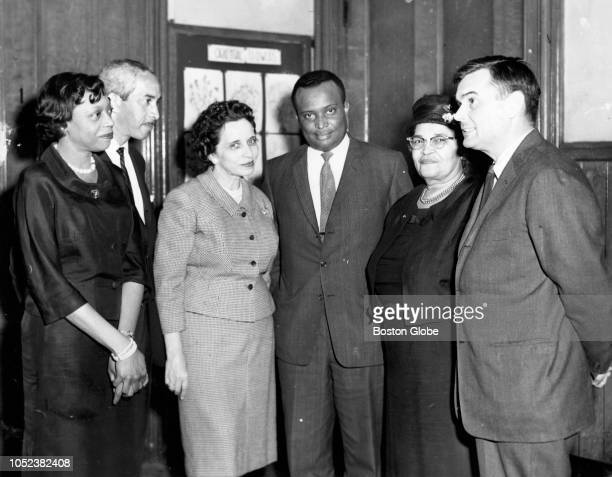 From left Mrs Rheable M Edwards chairman of the Boston branch of the NAACP housing committee Jack E Woods specialist in housing with the national...