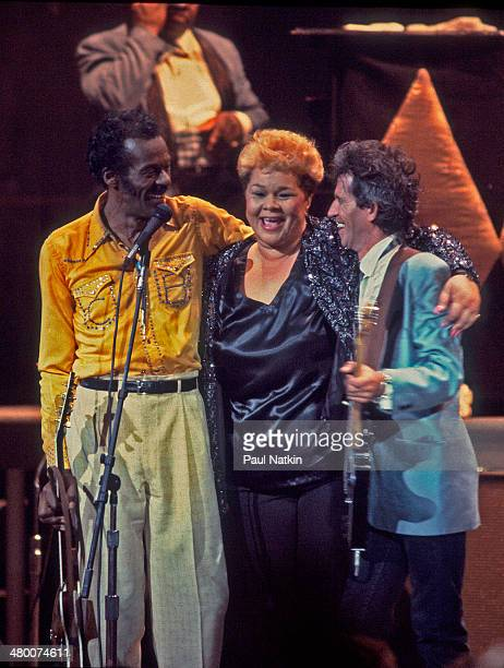 From left, musicians Chuck Berry, Etta James, and Keith Richards embrace onstage at the Fox Theater during the filming of the movie 'Hail! Hail! Rock...