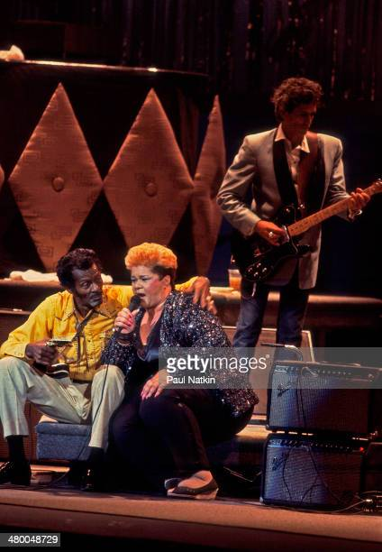 From left, musicians Chuck Berry, Etta James, and Keith Richards perform onstage at the Fox Theater during the filming of the movie 'Hail! Hail! Rock...