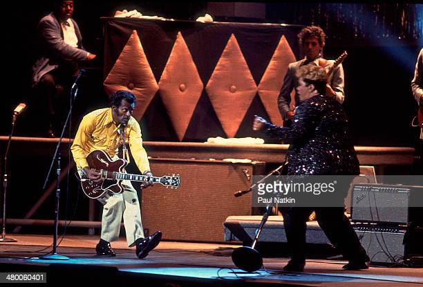 From left musicians Johnnie Johnson Chuck Berry Etta James and Keith Richards perform onstage at the Fox Theater during the filming of the movie...