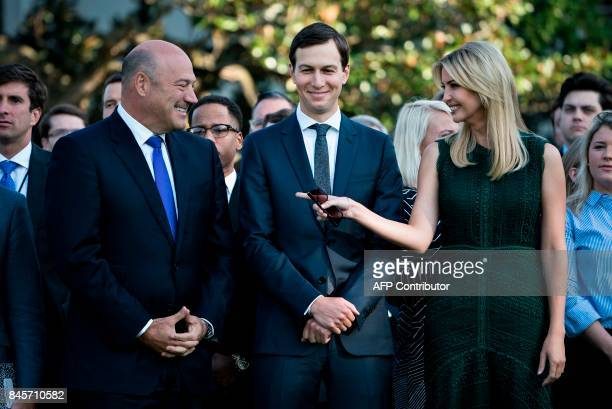 From left National Economic Council Director Gary Cohn Senior Advisor Jared Kushner and Ivanka Trump wait with others on the South Lawn of the White...