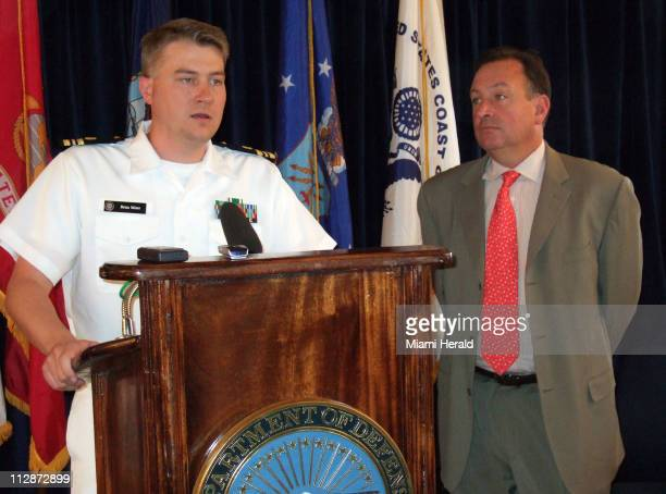From left Navy Lt Cmdr Brian L Mizer Pentagon appointed defense attorney to Yemeni driver Salim Hamdan and Harry H Schneider Jr a member of the team...