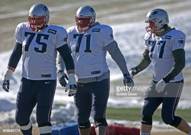 From left New England Patriots center Ted Karras offensive tackle Cameron Fleming and offensive tackle Nate Solder participate in warmups at Gillette...