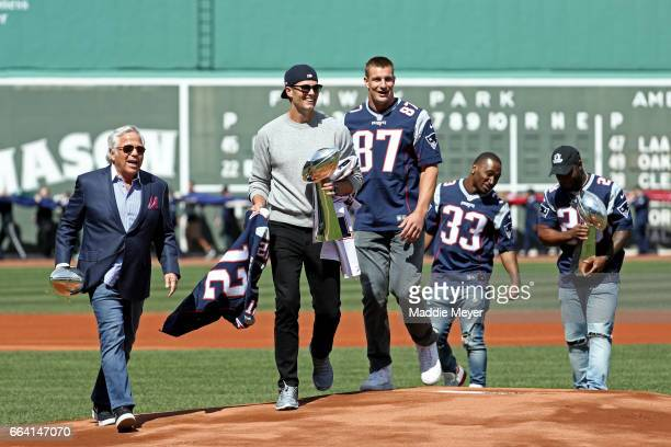 From left New England Patriots owner Robert Kraft Tom Brady Rob Gronkowski Dion Lewis and James White walk onto the field carrying Vince Lombardi...