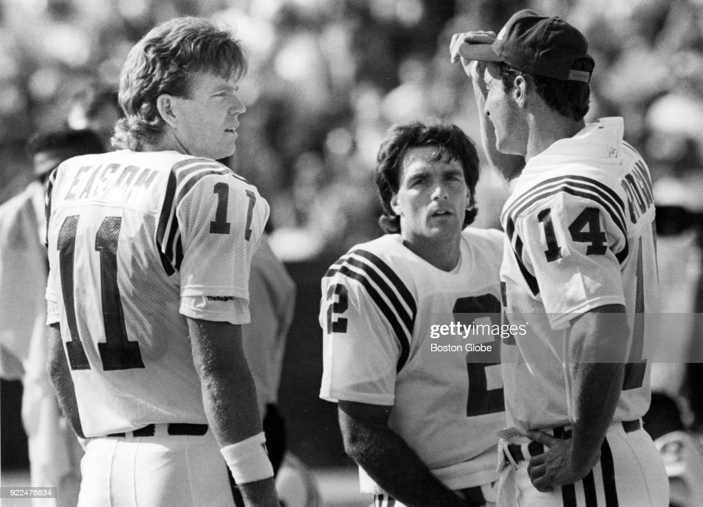 From left, New England Patriots Tony Eason, Doug Flutie, and Steve Grogan confer on the sidelines during a game against the Buffalo Bills at Rich Stadium in Orchard Park, N.Y., Oct. 1, 1989.