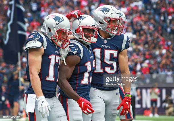 From left New England Patriots wide receivers Riley McCarron Phillip Dorsett and Chris Hogan celebrate together following Dorsett's touchdown...