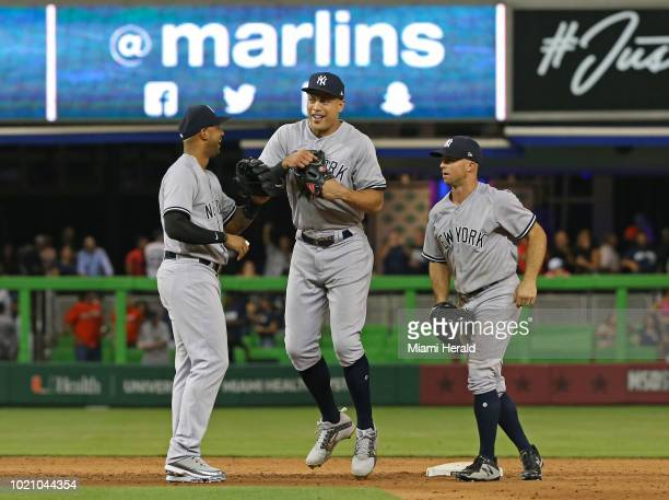 From left New York Yankees outfielders Aaron Hicks Giancarlo Stanton and Brett Gardner celebrate after a 21 win in 12 innings against the Miami...
