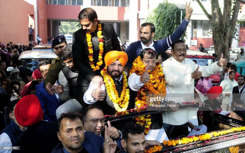 From left Newly elected Chandigarh senior deputy mayor Gurpreet Singh Dhillon Mayor Davesh Moudgil and Senior BJP leader Satpal Jain during road show.