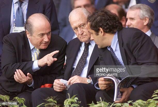 Newly elected FIFA's president Joseph Sepp Blatter Former FIFA's president Joao Havelange and CFO's president Michel Platini chat during the1998...