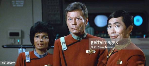 From left Nichelle Nichols as Commander Uhura DeForest Kelley as Dr Leonard 'Bones' McCoy George Takei as Commander Hikaru Sulu in the movie 'Star...