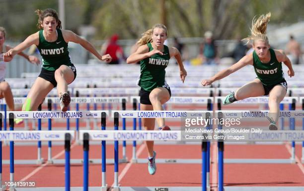 Niwot High School's Mackenzie Fidelak Kela Fetters and Alexis Carroll compete in the girls 100 meter hurdles during the Boulder County Track and...