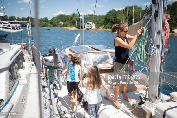 From left Noah Borel Ruby Bradford and Lilo Borel run past Victoria Bradford to the Borel family's boat to play The bradford have been sailing around...