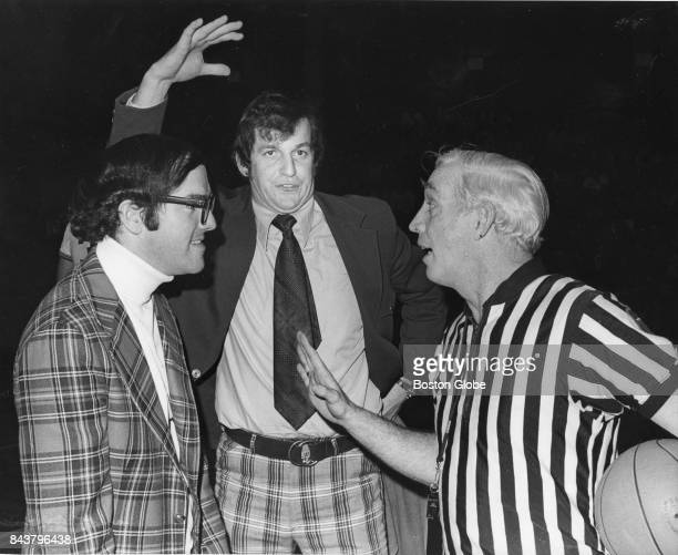 From left Northeastern University's assistant coach Buddy O'Niel and NU's head coach Jim Calhoun discuss a perceived missed goal tending call with...