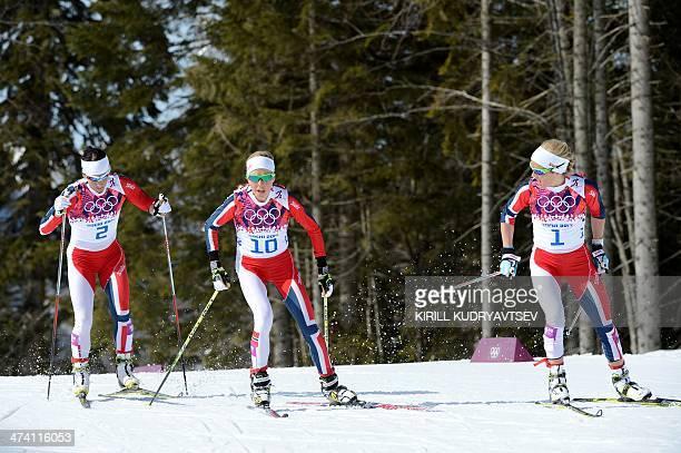 Norway's Marit Bjoergen Norway's Kristin Stoermer Steira and Norway's Therese Johaug compete in the Women's CrossCountry Skiing 30km Mass Start Free...