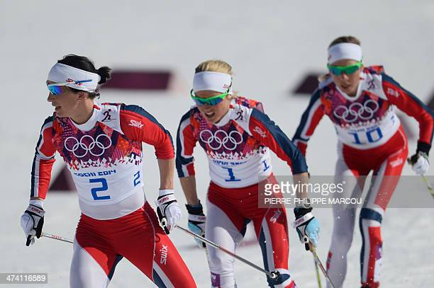 From left Norway's Marit Bjoergen Norway's Therese Johaug and Norway's Kristin Stoermer Steira compete in the Women's CrossCountry Skiing 30km Mass...