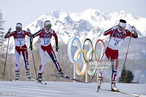 Norway's Therese Johaug Norway's Kristin Stoermer Steira and Norway's Marit Bjoergen compete in the Women's CrossCountry Skiing 30km Mass Start Free...