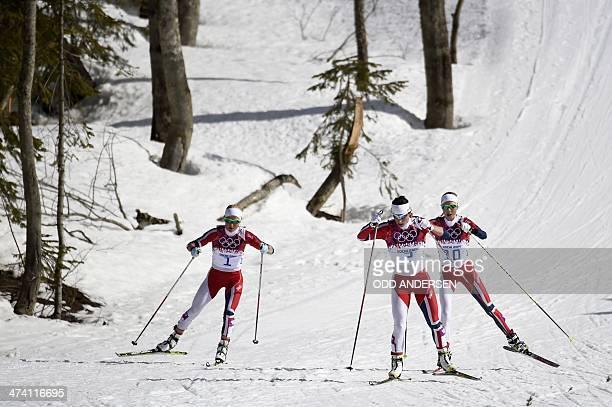 Norway's Therese Johaug Norway's Marit Bjoergen and Norway's Kristin Stoermer Steira compete in the Women's CrossCountry Skiing 30km Mass Start Free...