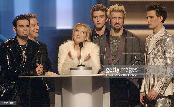 From left N'Sync's Chris Kirkpatrick Lance Bass Justin Timberlake Joey Fatone and JC Chasez are joined by host Kathy Griffin center while they...