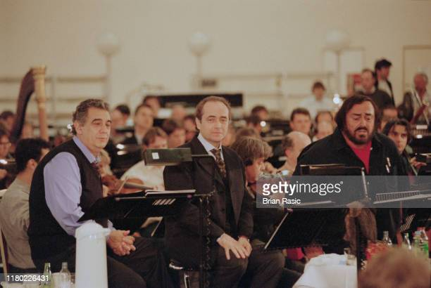 From left opera singers Placido Domingo Jose Carreras and Luciano Pavarotti of the operatic singing group The Three Tenors in rehearsal with an...