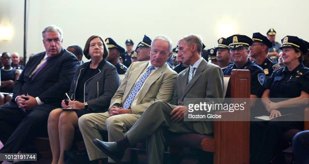 From left past Boston Police Commissioners Ed Davis Kathleen O'Toole Paul Evans and William Evans wait for the start of the ceremony where William G...