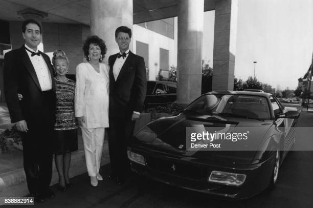 From left Paul Brooks Janice DeTemple Irene Zarlengo and Denver post publisher Ryan McKibben pose for a snap with a Ferrari in front of Loews Georgio...
