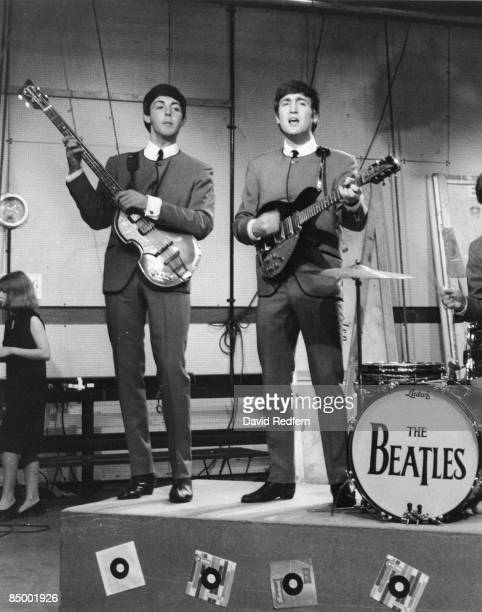 From left, Paul McCartney and John Lennon of English rock and pop group The Beatles, on stage during rehearsals for the Associated Rediffusion music...