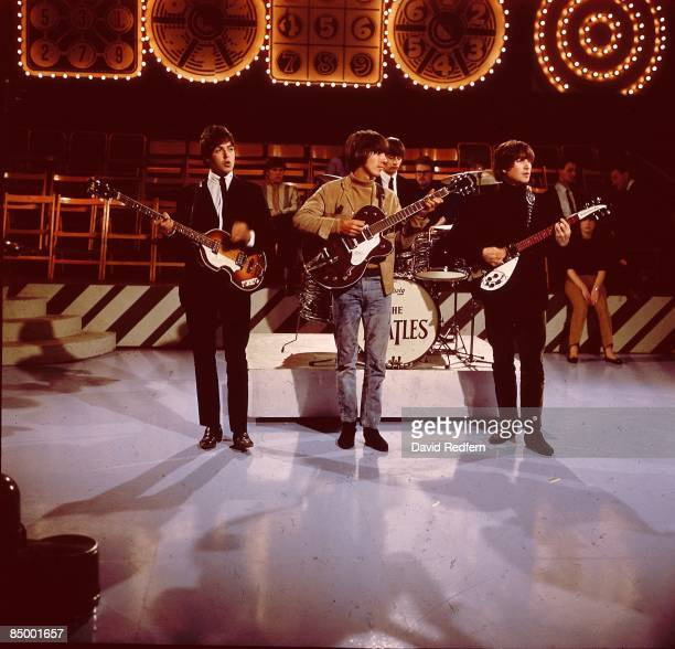 From left Paul McCartney George Harrison Ringo Starr and John Lennon of English rock and pop group The Beatles perform together on stage during...