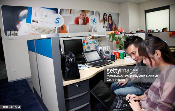 From left Paypal China Digital Marketing Manager Victor Yuan confers with Digital Marketing Specialist Rella Ren at PayPal's China offices in...