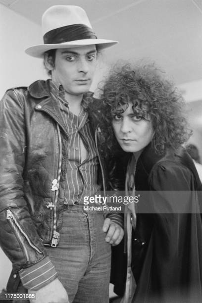 From left, percussionist Mickey Finn and singer and guitarist Marc Bolan of English glam rock group T Rex posed off stage prior to performing the...