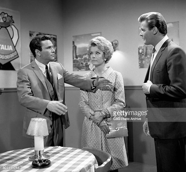 From left Peter Falk as attorney Daniel J OBrien Joanna Barnes as Katie OBrien and Roger Moore as Roger Taney in the TRIALS OF O'BRIEN episode What...