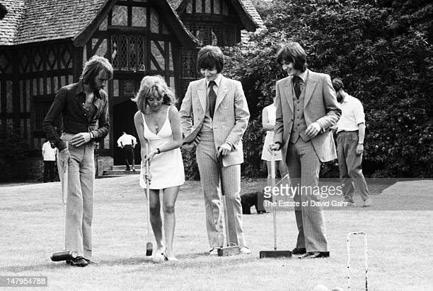 From left Pop singer Lulu her husband Maurice Gibb of the musical group the Bee Gees and pop duo Tin Tin enjoy a a game of croquet at a recording...