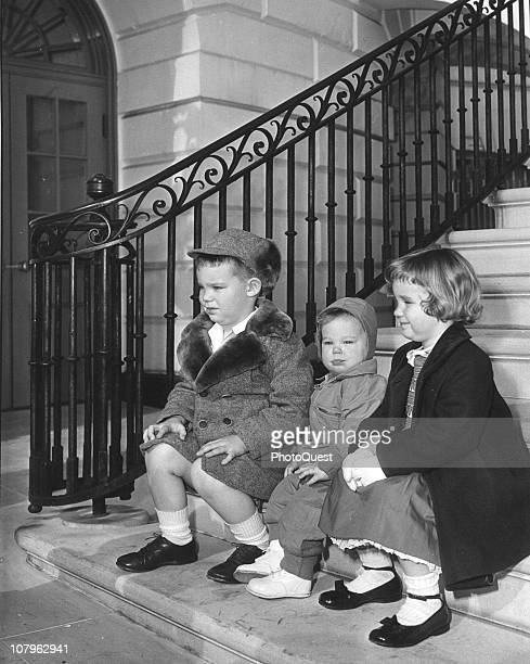 From left portrait of David Susan and Barbara Anne Eisenhower as they pose on a staircase at the White House Washington DC March 13 1953 The trio are...