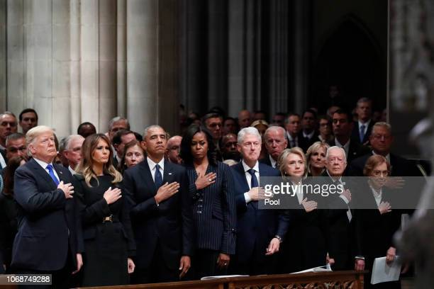 From left President Donald Trump first lady Melania Trump former President Barack Obama former first lady Michelle Obama former President Bill...