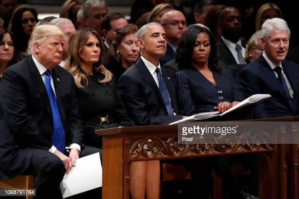 From left President Donald Trump first lady Melania Trump former President Barack Obama Michelle Obama and former President Bill Clinton listen as...