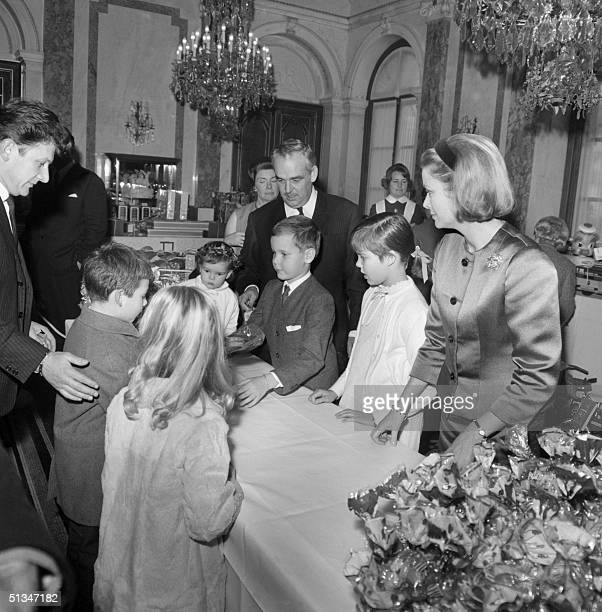 From left Princess Stephanie Prince Rainier III Prince Albert Princess Caroline and Princess Grace offer gifts to some MonteCarlo children during...