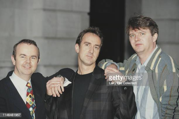 From left Private Eye editor Ian Hislop television presenter Angus Deayton and comedian Paul Merton stars of the topical BBC television panel show...