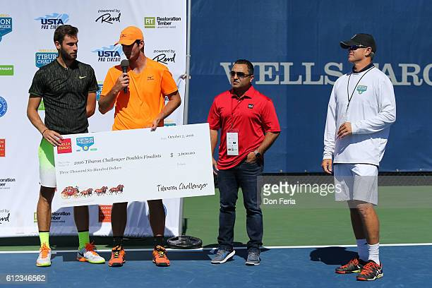 From left Quentin Halys and Dennis Novikov receive their runnerup check after the doubles final of the 2016 Tiburon Challenger with Title Sponsor...