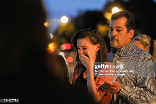 Rachel Waltz and Geoff Waltz listen as a bible verse is read during a candlelight vigil for Jason Grimmer Monday July 15 in the 2200 Block of Main...