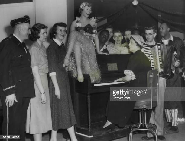 From Left Ralph Murphy Nancy Allison Joyce Barnes Nancy Negri Mrs Camille Doyle and John Barun Behind Piano from left are Pfc Jack Myles Pfc Bryan...