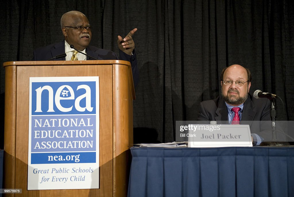 From left, Reg Weaver, president of the National Education Association, and Joel Packer, director of education policy and practicer for the National Education Association, participate in the NEA briefing on redefining the Federal role in K-12 education during the NEA's 2008 Annual Meeting at the Washington Convention Center on Wednesday, july 2, 2008.