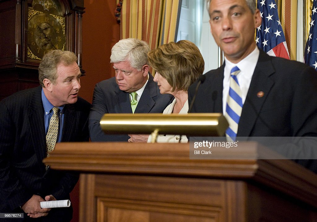 From left, Rep. Chris Van Hollen, D-Md., Rep. John Larson, D-Conn., and Speaker of the House Nancy Pelosi, D-Calif., talk as Rep. Rahm Emanuel, D-Ill., speaks during in the Speaker's weekly news conference on Thursday, July 10, 2008.