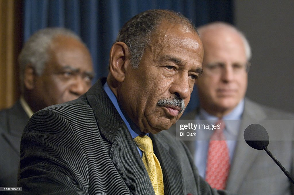 From left, Rep. Danny Davis, D-Ill., House Judiciary Chairman John Conyers, Jr., D-Mich., and Rep. Christopher Shays, R-Conn., participate in the news conference to introduce the 'End Racial Profiling Act of 2007,' on Thursday, Dec. 13, 2007.